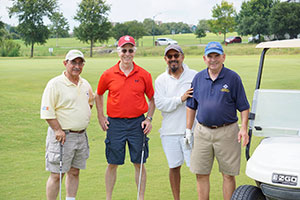 A team of four players at the 2017 golf tournament